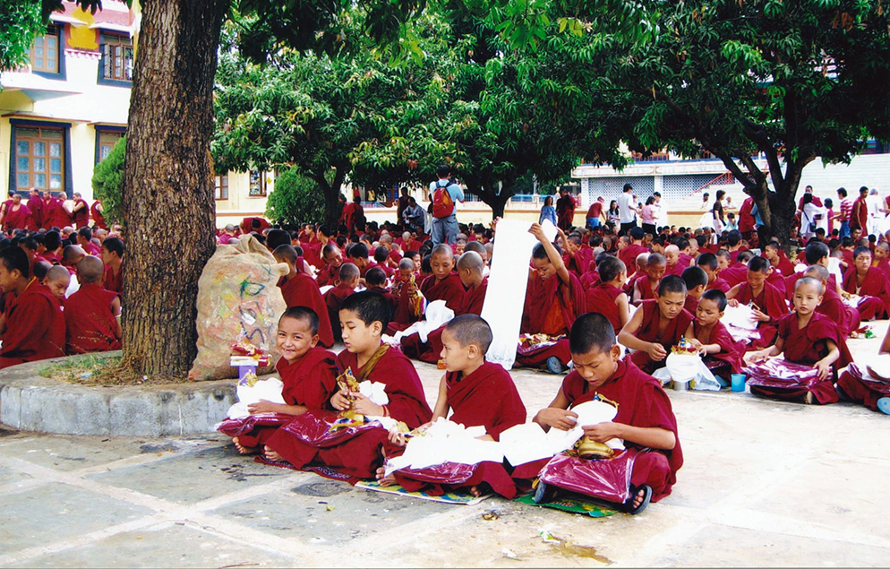 Young monks with their Manjushri statue and monk's robes, offered by His Eminence Tsem Rinpoche and Kechara