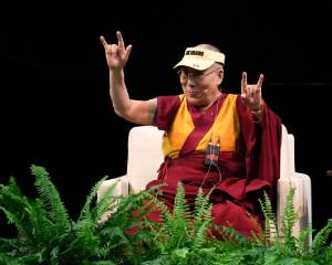 "BOULDER, CO - June 23: His Holiness the Dalai Lama duplicates sign language from an audience member expressing ""I love you"" during the Compassion in Action event at the Coors Events Center June 23, 2016. (Photo by Andy Cross/The Denver Post)"
