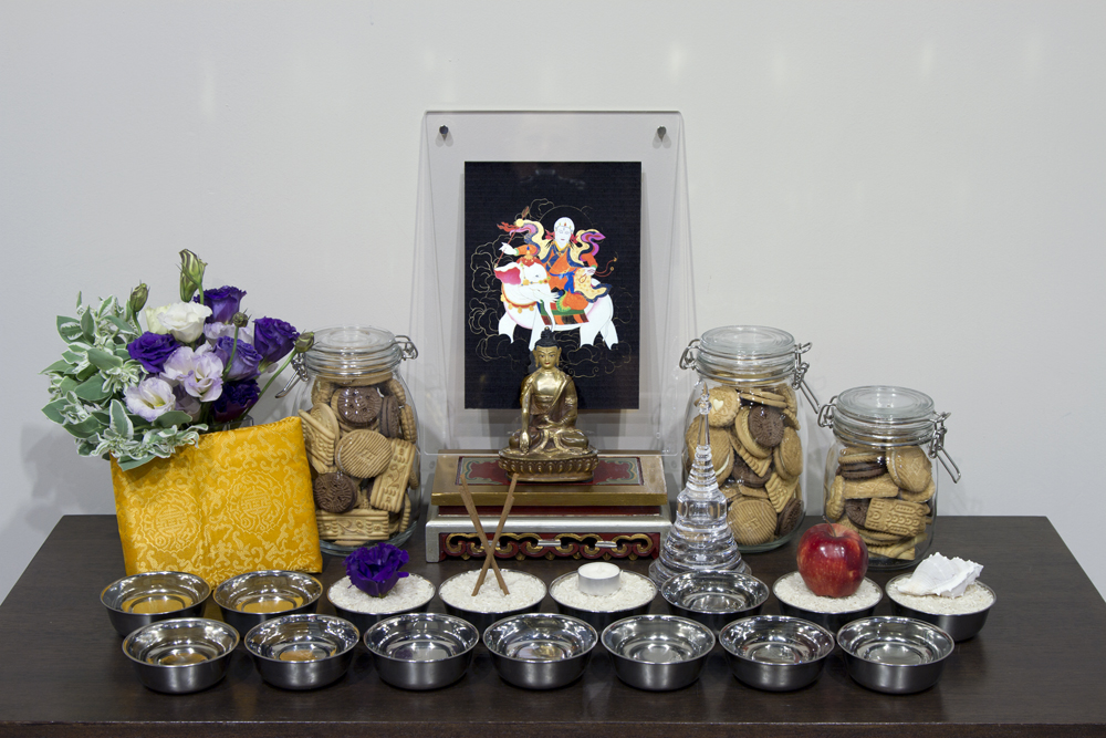 A more simple altar set up. Practitioners who are not able to make traditional tormas can use jars filled with cookies as a replacement.