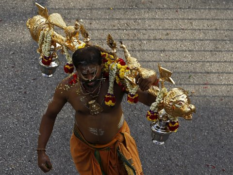 A devotee bearing a elaborate and golden kavadi