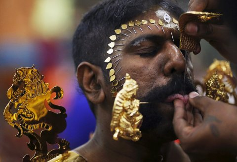 Kavadi bearers also show their devotion by using ornate and and even golden 'vel' or spears to pierce themselves as part of the Thaipusam festival