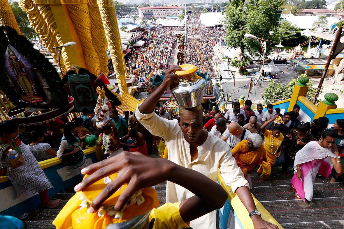 Thousands of devotees climb the stairs to the temple inside Batu Caves every year during Thaipusam (Photo by Olivia Harris/Reuters)