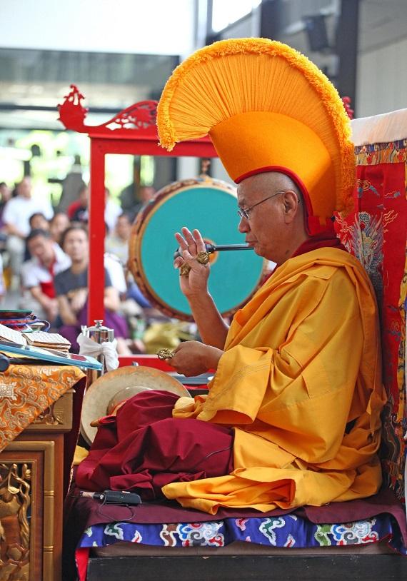 Chojela doing rituals during puja