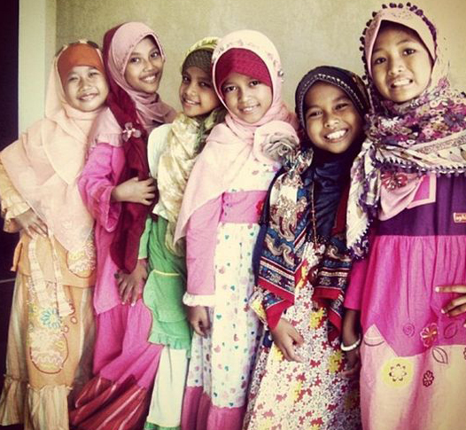 Children wearing tudung