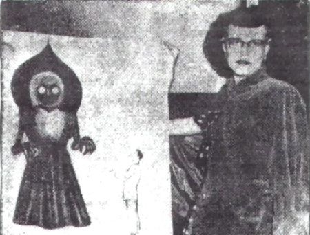 """In a photo taken in Charleston, one of the eyewitnesses, Mrs Kathleen May, poses with an artist's rendition of the Flatwoods Monster based on her account. The group gained some notoriety after the signing, and were invited to speak on a number of shows about their experiences, including on """"We The People"""" filmed in New York."""