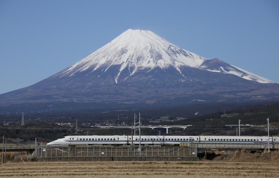 A Shinkansen bullet train speeds past snow-capped Mount Fuji in the city of Fuji, Shizuoka prefecture, Japan, Feb 7, 2017. [Photo/VCG]