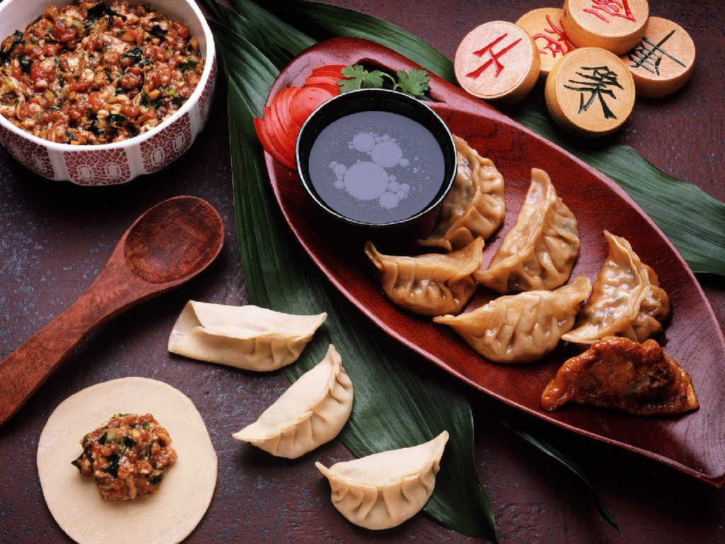 Jiaozi is another dumpling dish that resembles the gold or silver ingots. It is dish that is believed to bring you luck throughout the year.