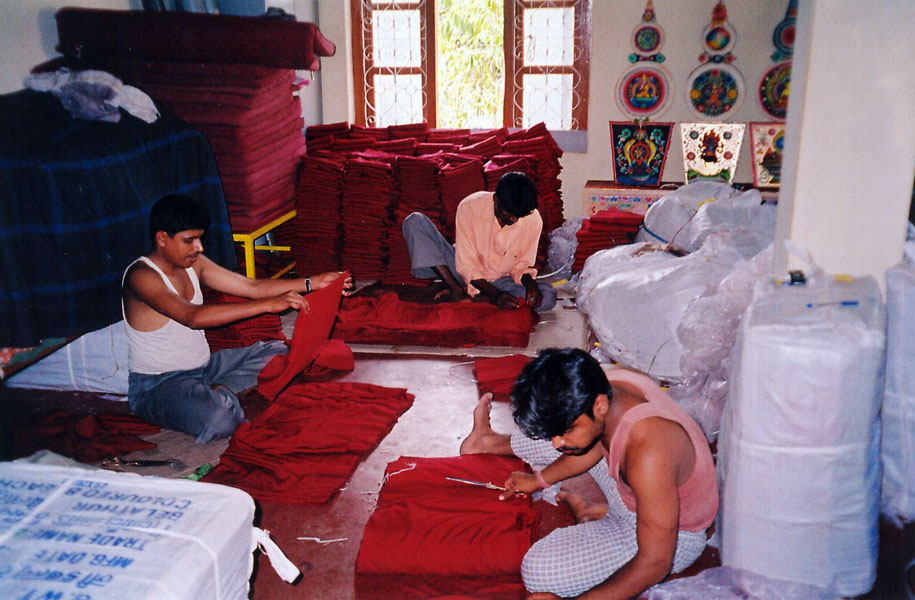 Workers preparing maroon cloth for the 3000 robes that was offered to every single monk in Gaden Monastery.