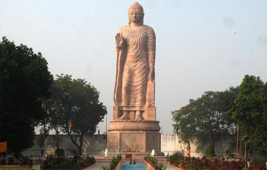 Giant standing Buddha on the grounds of Wat Thai Sarnath