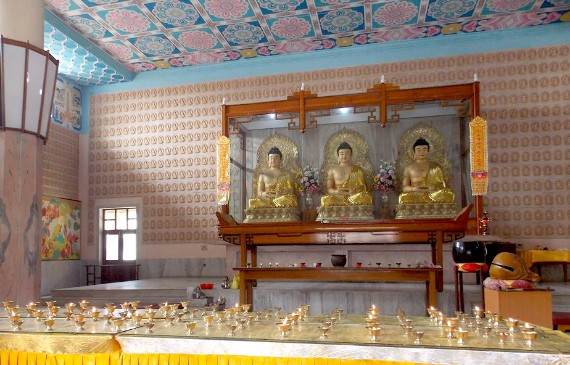 The Chinese Temple is enshrined with three smiling Amitabha Buddhas
