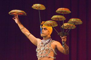 Man performing the Raban Dance and balancing drums in a tourist show at the Kandyan Arts Association Hall, Kandy, Sri Lanka, Asia