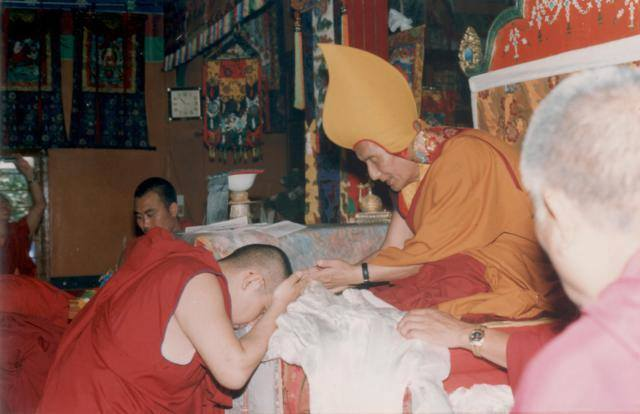 His Holiness Kyabje Ling Chocktrul Rinpoche offers a khata to His Holiness the 101st Gaden Tripa Jetsun Lungrik Namgyal in Gaden Lachi shortly after he received the title of Gaden Tripa.