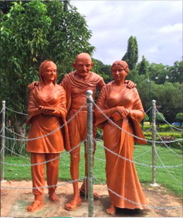 The statue of Mahatma Gandhi and two women at the Mahatma Gandhi Park in Bengaluru, India