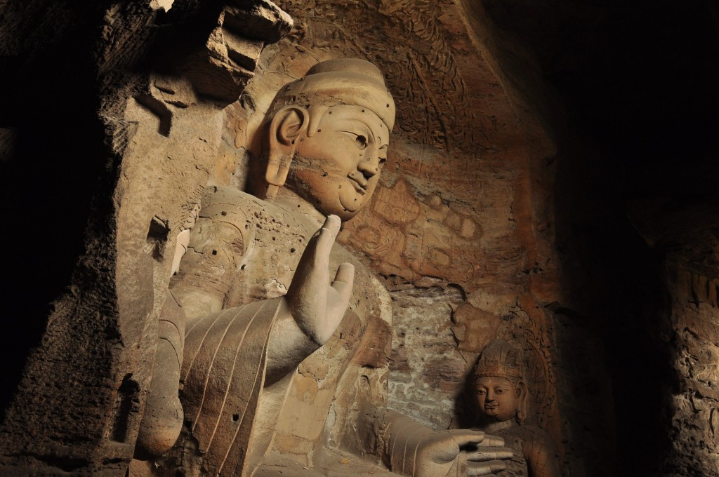 A statue of the Buddha at Yungang Grottoes in in Datong city, Shanxi Province, China. This is just one of 51,000 Buddhist statues carved at the ancient cave site where Buddhist practice once flourished