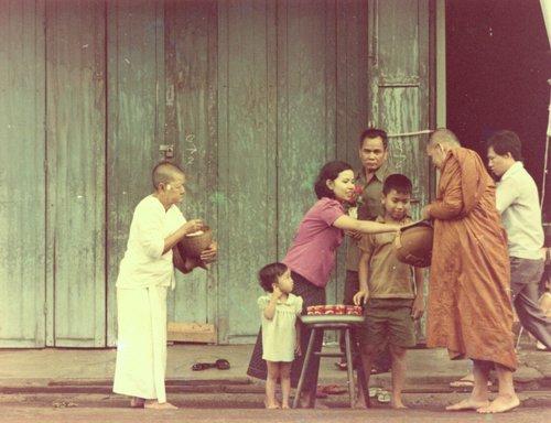 Ajahn Chah receiving alms form local villagers