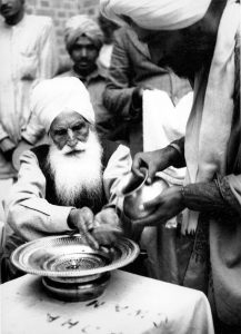 Baba Sawan Singh washing his hands in Dera Baba Jaimal Singh