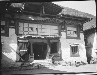 An old picture of the entrance to the main shrine room of Dungkar Monastery