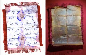The paper containing the secret mantra before the blessing (left) and after the blessing (right)