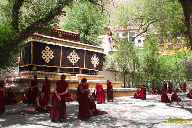 The courtyard of Sera Monastery with monks in a debate