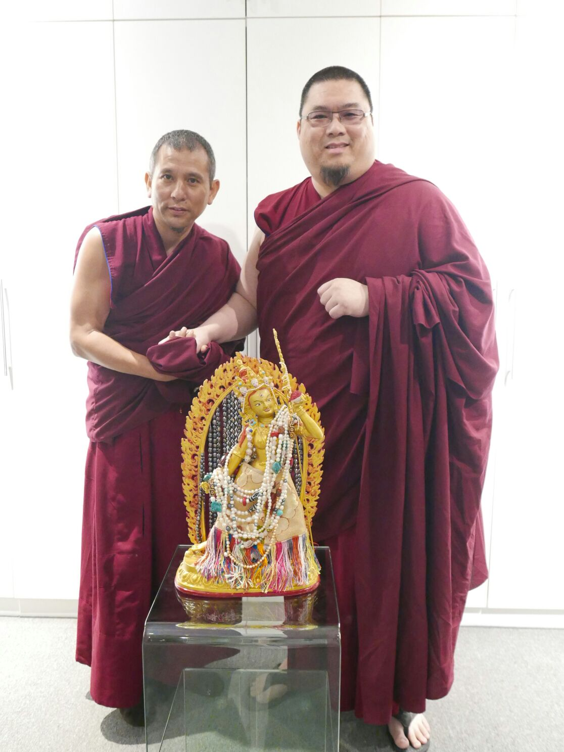 Rinpoche offering a Vajra Yogini statue to Geshe Phuntsok's retreat. Click on image to enlarge.